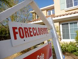 Picture of foreclosure sign in front of house, saratoga springs ny