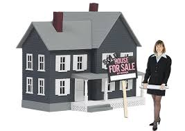 Real estate agent standing in front of a sold house.